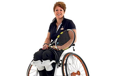 Olympic champion Sharon Walraven riding Magnesium Wheels wheelchair wheels.